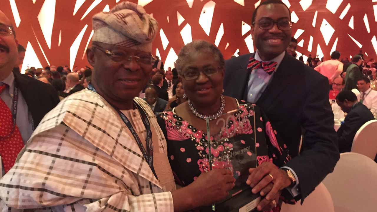 Winner of the 2016 Africa CEO Forum Award and Chairman, Honeywell Group, Dr. Oba Otudeko (left); being congratulated by former Minister of Finance, Dr. Ngozi Okonjo-Iweala and President of the African Development Bank, Dr. Akinwunmi Adeshina in Abidjan, Côte d'Ivoire.