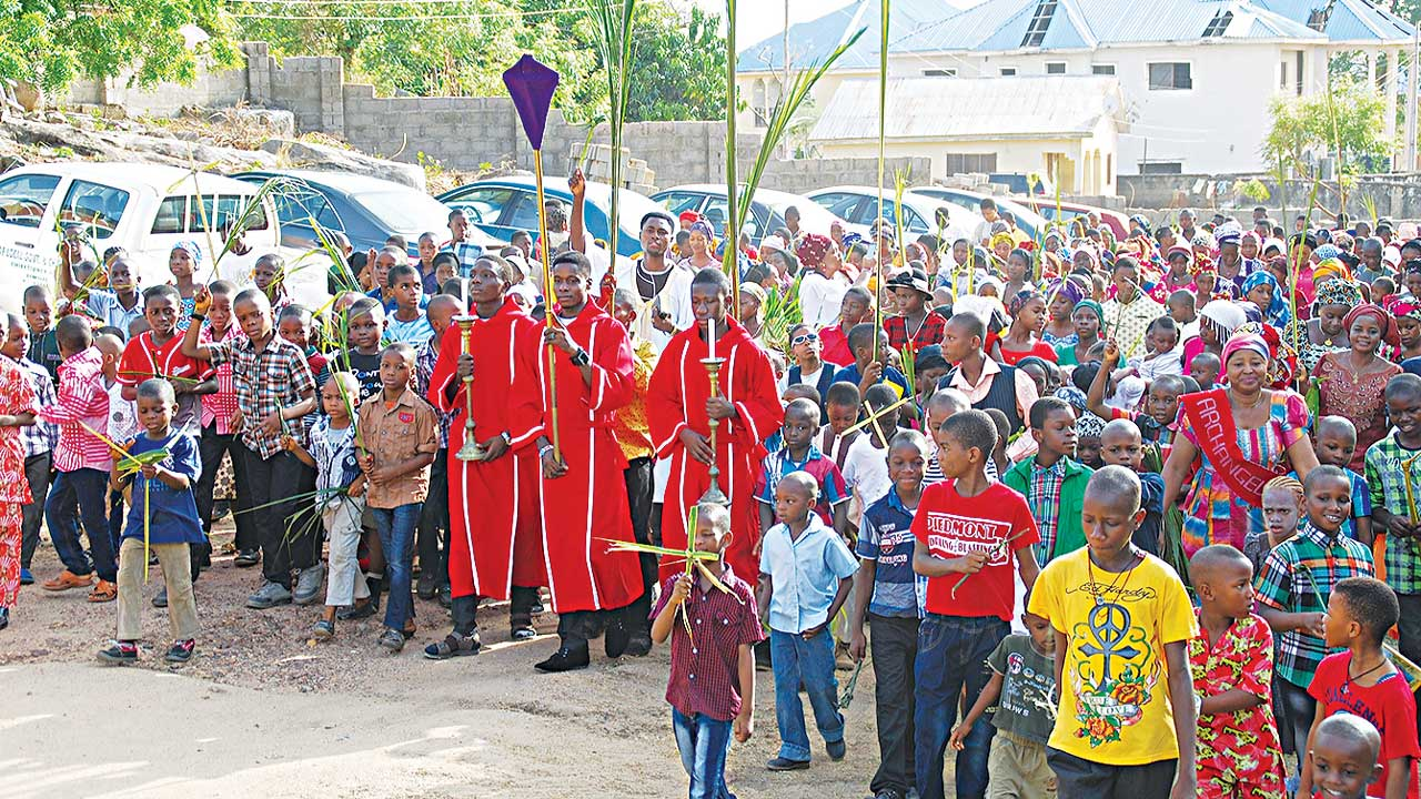 Palm Sunday procession at SS Michael, Gabriel and Raphael Catholic Parish Church, Gadumo in Lokoja... yesterday.