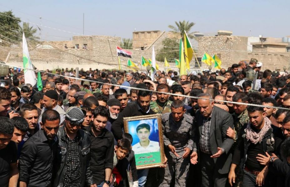 Iraqi Turkmen Shiite mourners gather during a mass funeral for 22 members of the Popular Mobilisation units, who were killed the month before during clashes with Islamic State (IS) group jihadists in the the city of Basheer on March 15, 2015 (AFP Photo/Marwan Ibrahim)