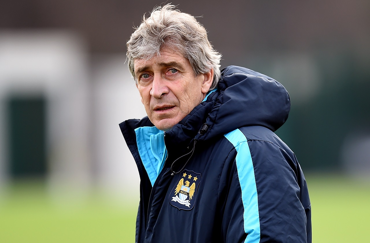 Manchester City's Chilean manager Manuel Pellegrini takes part in a training session in Manchester on February 26, 2016, ahead of the English League Cup Final against Liverpool at Wembley Stadium on Sunday February 28, 2016.  / AFP / PAUL ELLIS / RESTRICTED TO EDITORIAL USE. No use with unauthorized audio, video, data, fixture lists, club/league logos or 'live' services. Online in-match use limited to 75 images, no video emulation. No use in betting, games or single club/league/player publications.  /