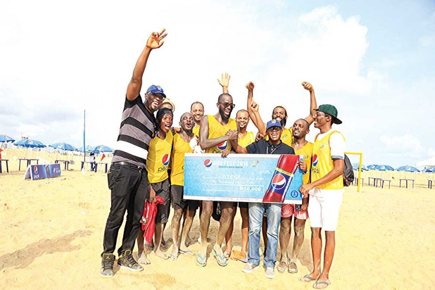 Manager Marketing, Seven-Up Bottling Company Plc, Mr. James Adah and Brand Manager, Seven-Up Bottling Company Plc, Mr. Segun Ogunleye (fifth left), celebrating with Team NTDIL, winners of Pepsi Corporate  Beach Soccer at Gidi Fest held at the Eko Atlantic Beach, Lagos… at the weekend.