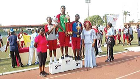 Chairperson of the occasion and Proprietress, Mercyland Group of Schools, Abeokuta, Dr. (Mrs.) Anuoluwapo Ayodele Bankole (right), during the presentation of trophies to winners at the Mind Builders Schools Inter-House Sports at the Agege Stadium…Recently.