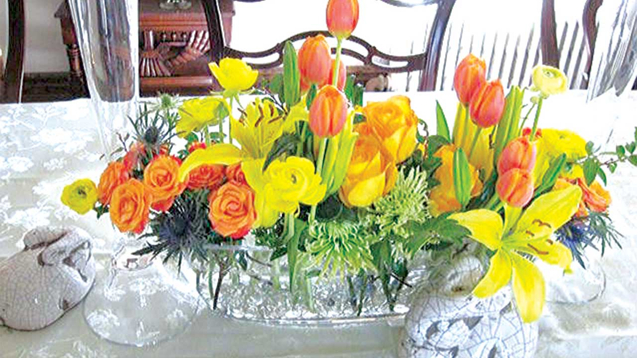 Florist design for the season: lilies,tulips, roses, mums, thistles.
