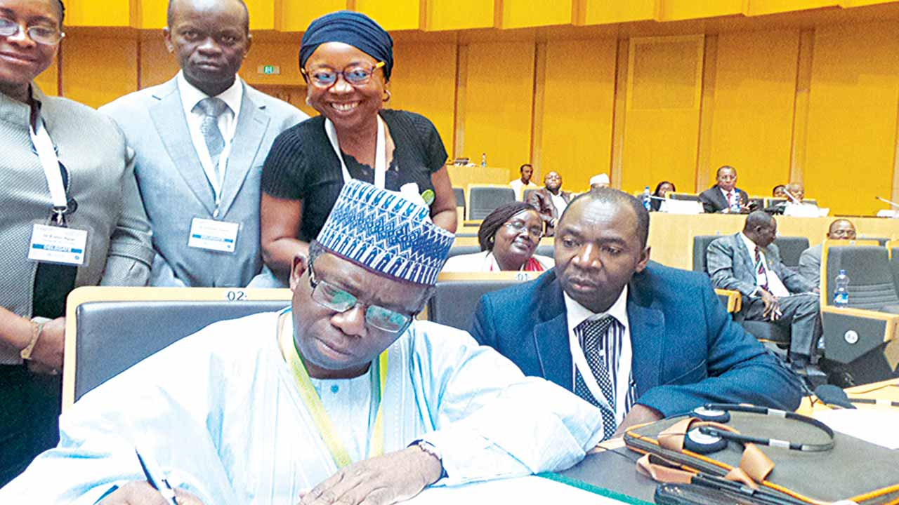 "Nigeria's Minister of Health, Prof. Isaac Adewole (left); Executive Director of the National Primary Health Care Development Agency (NPHCDA), Dr. Ado Muhammad; and other members of the Nigerian delegation (standing at the back) as the Minister took his turn to sign a new global declaration made by African leaders on ""Universal access to immunization as a cornerstone for health and development,"" made at the African Union (AU) headquarters, Ethiopia, at the weekend.                                                                                                                                  PHOTO: EMEKA ANUFORO"