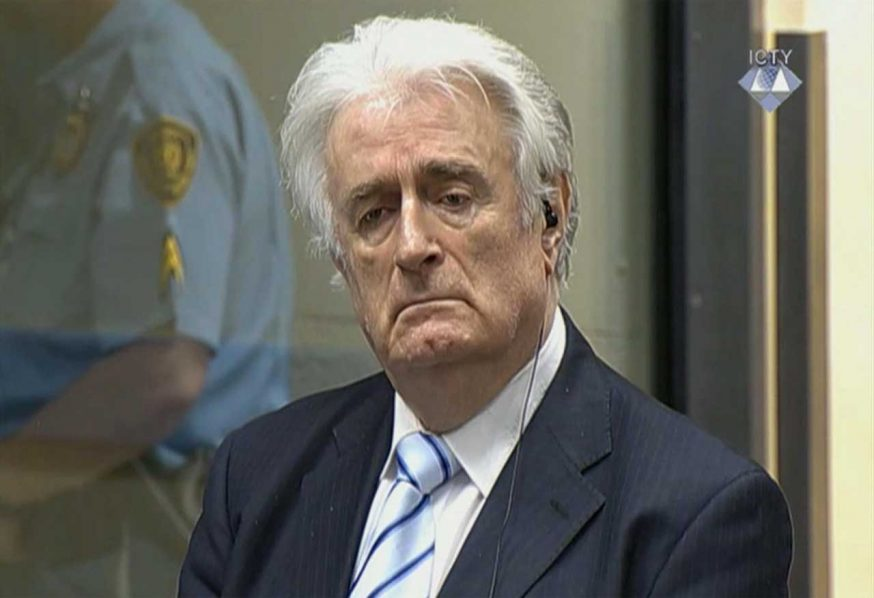 Bosnian Serb wartime leader Radovan Karadzic listens to the verdict at the International Criminal Tribunal. PHOTO: washingtonpost.