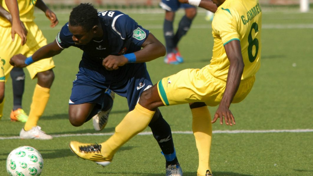 Photo credit: Goal.com Rivers United FC in yellow jersey in a Football game with Enyinba FC