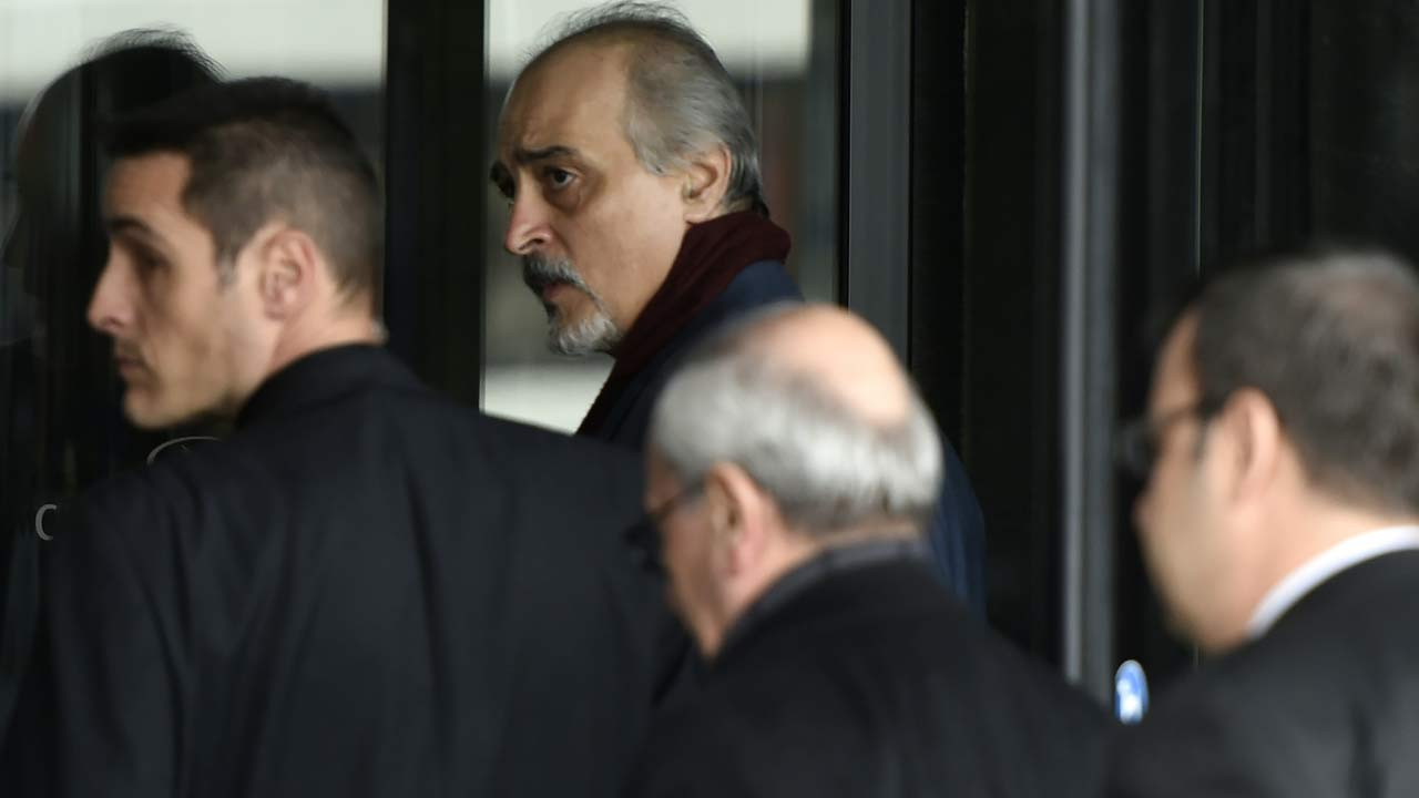 "Syrian Ambassador to the United Nations (UN) and Head of the Government delegation Bashar al-Jaafari (rear C) arrives for the second round of Syrian peace talks in Geneva on March 13, 2016. Syria's warring sides prepared on March 13 for a new round of peace talks after locking horns over the fate of President Bashar al-Assad, with the regime insisting his ouster was a ""red line"" while the opposition vowed to see him go -- dead or alive. The negotiations are set to cover the formation of a new government, a fresh constitution and UN-monitored presidential and parliamentary elections within 18 months. PHILIPPE DESMAZES / AFP"