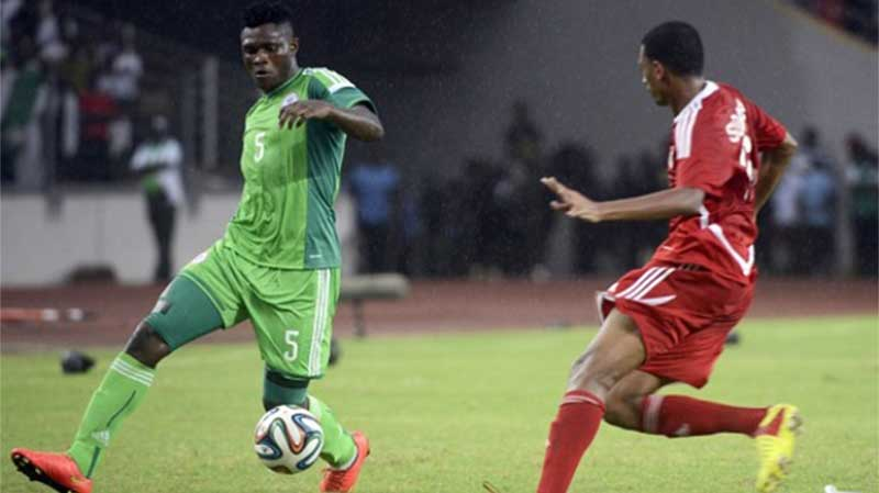 Super Eagles' Striker, Aaron Samuel (left), takes on a Sudanese star during the ill-fated campaign to qualify for the Equatorial Guinea 2015 AFCON. Samuel believes Nigeria will pip Egypt to Group G's sole Gabon 2017 ticket.
