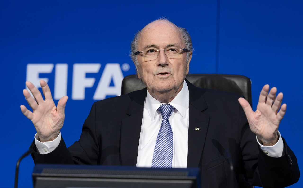 (FILES) This file photo taken on July 20, 2015 shows outgoing FIFA president Sepp Blatter gesturing during a press conference at the football's world body headquarter's in Zurich. Along with the Italian-Swiss secretary general of the European federation Gianni Infantino, Bahrain's ruling dynasty, Sheikh Salman bin Ebrahim Al-Khalifa is considered a top favourite to win the post on February 26, 2016 to succeed Blatter, who has been suspended for eight years over corruption.   / AFP / FABRICE COFFRINI