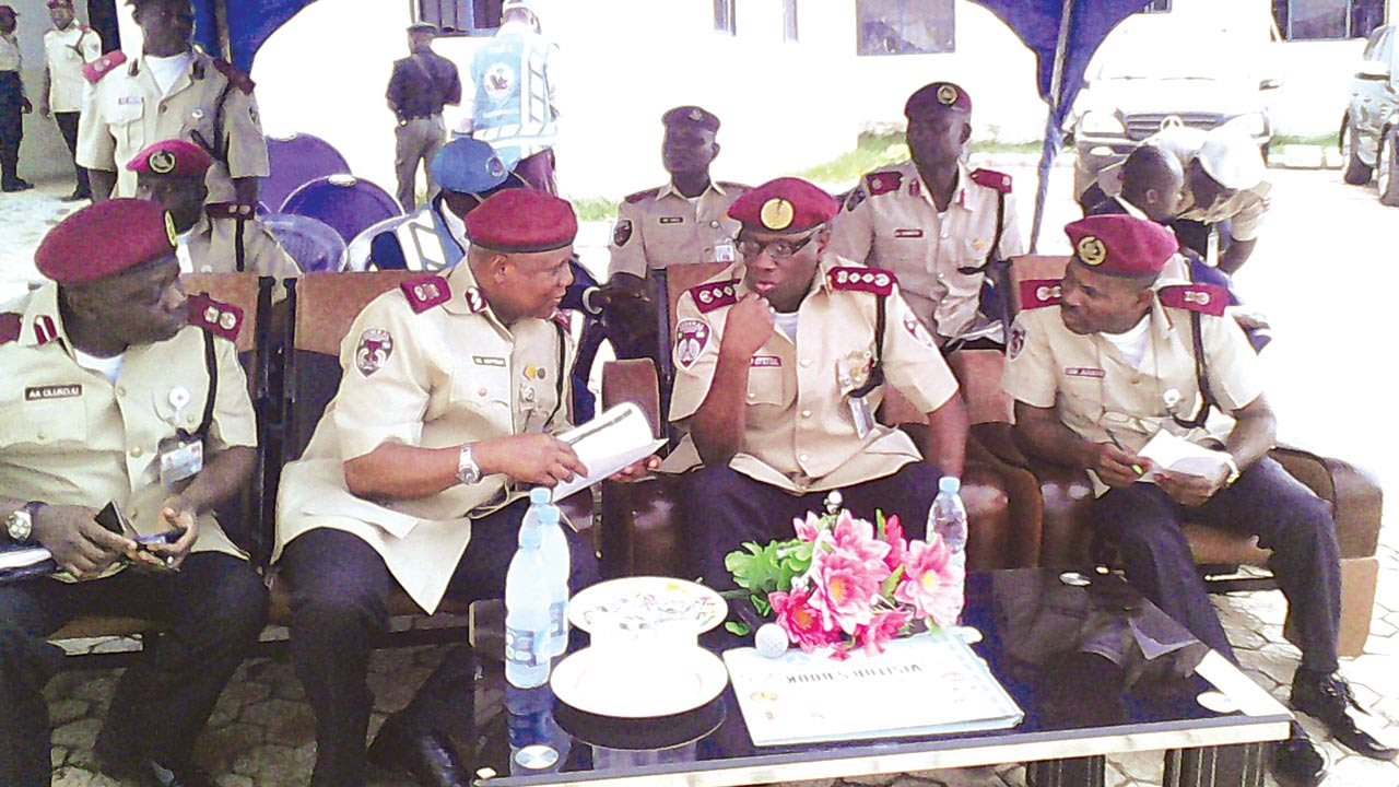 FRSC boss, Mr. Boboye Oyeyemi (second left), rubbing minds with corps officials at a functionPHOTO:NAN