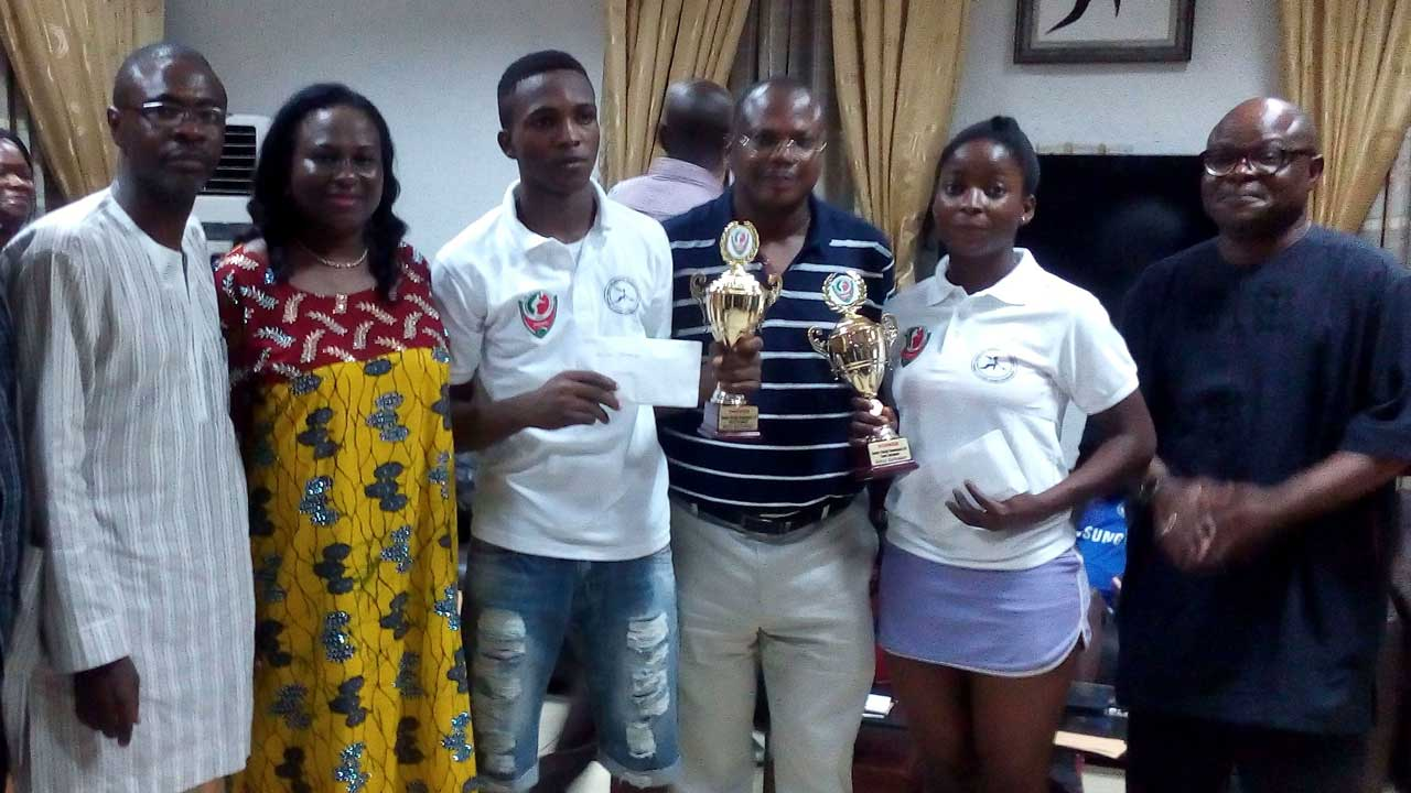 Chairman of the Squash Section, Lagos Country Club, Mr. Funmi Bamkole, wife of the sponsor, Mrs. Nike Olasunkanmi, winner in the boys' category, Temiloluwa Adegoke, tournament sponsor, Senator Akinlabi Olasunkanmi, winner in the Girls' category, Busayo Olatunji and President of Lagos Country Club, Kayode Moradeyo, at the end of the Senator Akinlabi Olasunkanmi U-19 Squash Tourney.