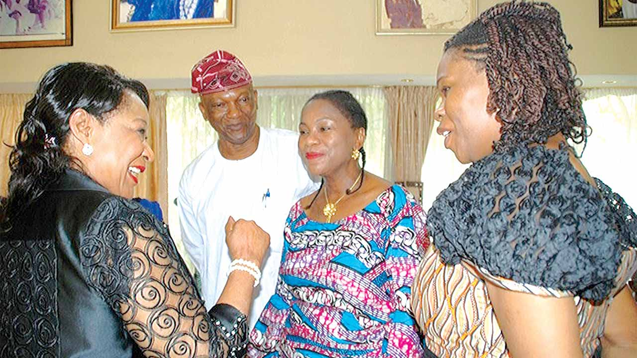Chief (Mrs.) Nike Akande (left) and Jimi Agbaje with Omowunmi and Ebun, daughters of the late Tunji Braithwaite.