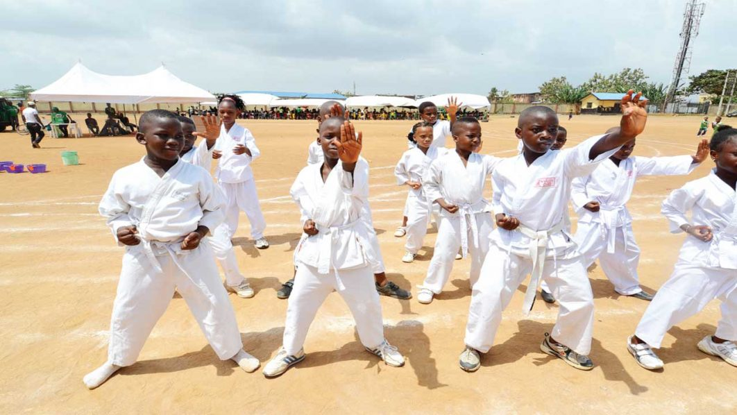 Pupils of Cedar Heights Demonstration School, Ejigbo, Lagos, displaying their karate skills during the school's recent inter-house sports competition.