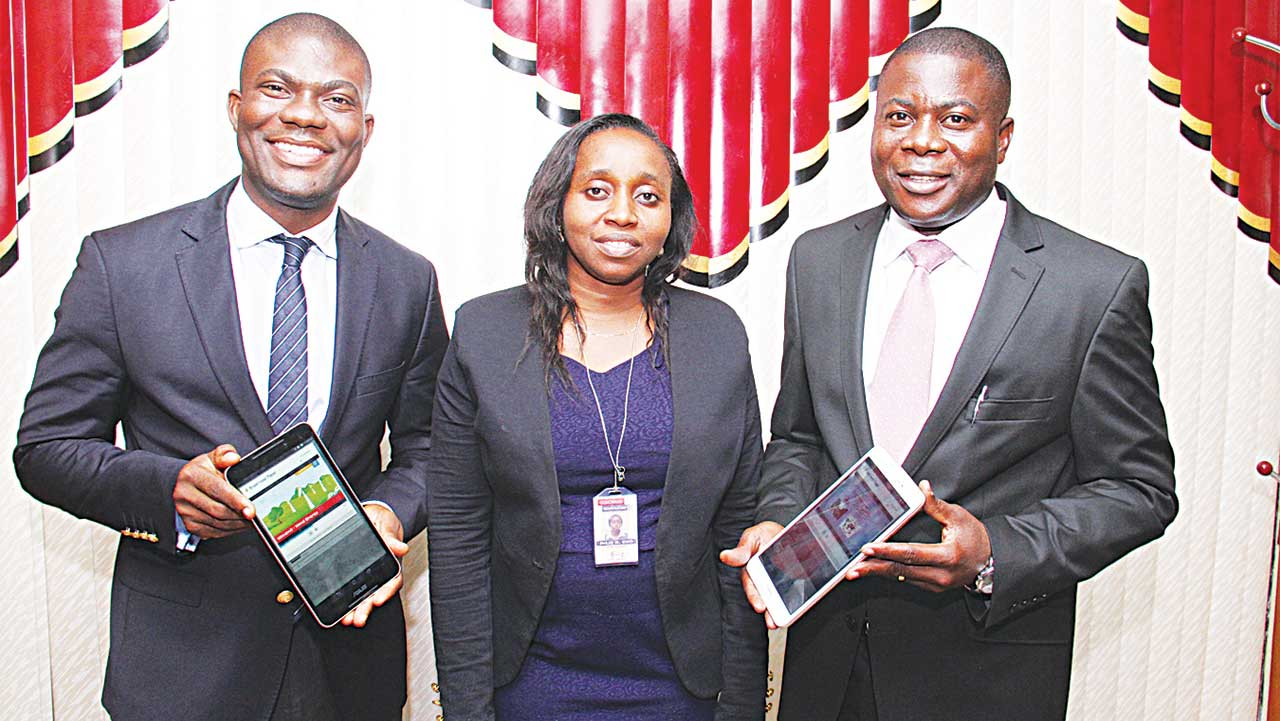 Managing Director, Cinfores, Asawo Ibirufo (left); ASUS Product Head, Julie Eno and Managing Director Emomine Mukoro, both of Coscharis Technologies during the  Coscharis Edu-Mobile launch held recently in Lagos.