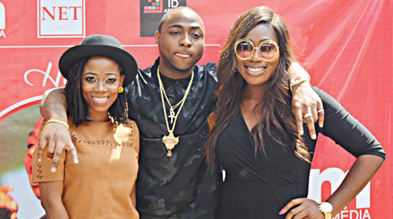 Tosyn Bucknor, Davido and Gnemi at the reception.