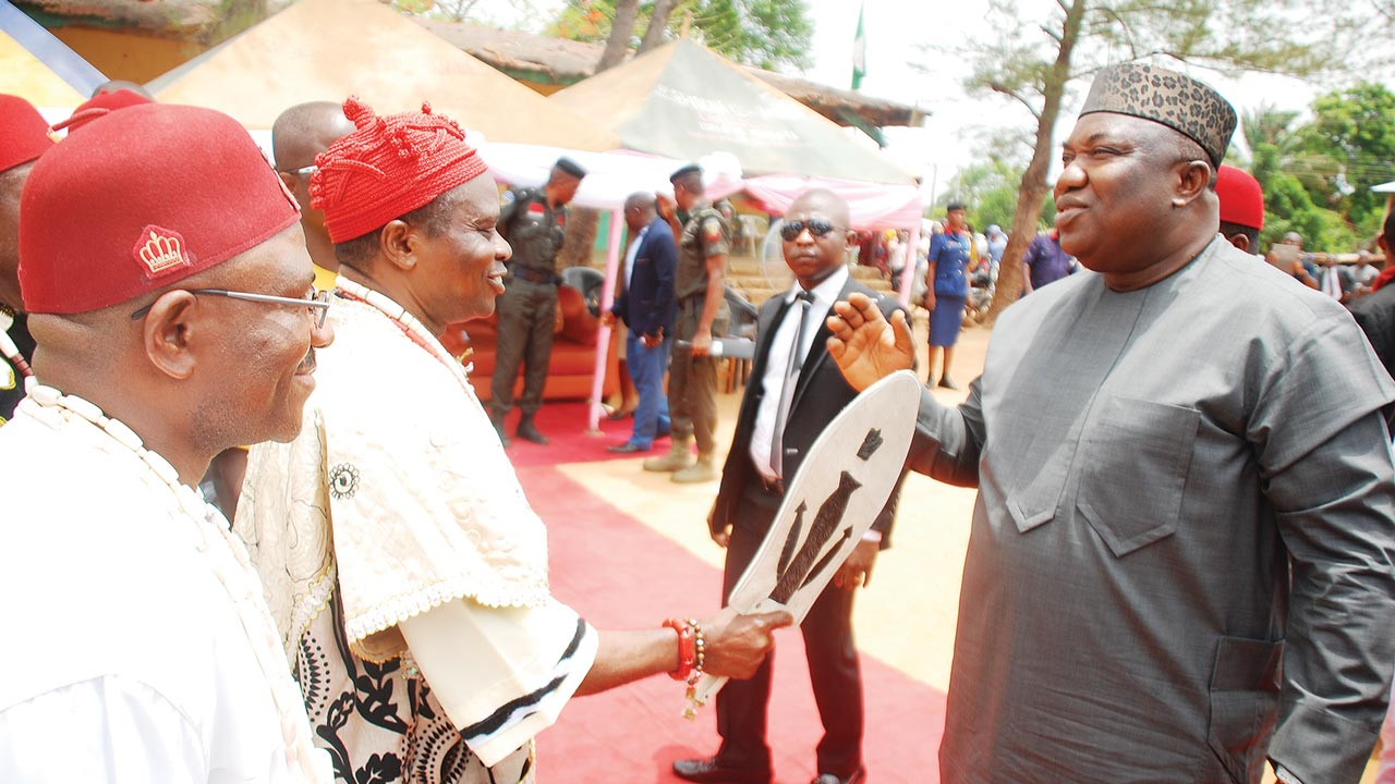 Governor of Enugu State, Ifeanyi Ugwuanyi, (right), being received by the traditional ruler of Ugwulesi, Awgu community, Igwe Godwin Nwobi, during the governor's visit to the area to sympathise with families of the 76 farmers, who are detained in prison at Umuahia, Abia State, over clash with Fulani herdsmen