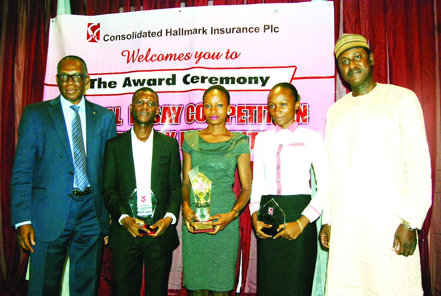 Managing Director/Chief Executive Officer, Consolidated Hallmark Insurance Plc, Eddie Efekoha (left); Second prize winner from University of Uyo, Julius Olabiyi; First winner, of The Polytechnic, Ibadan, Miss Florence Ogunleye; Third winner, of University of Uyo, Miss Eskwu Ifeanyichukwu, and  Director, Research and IT, National Insurance Commission,  Adamu Balanti, at the company's yearly essay competition for tertiary institutions  in Lagos.