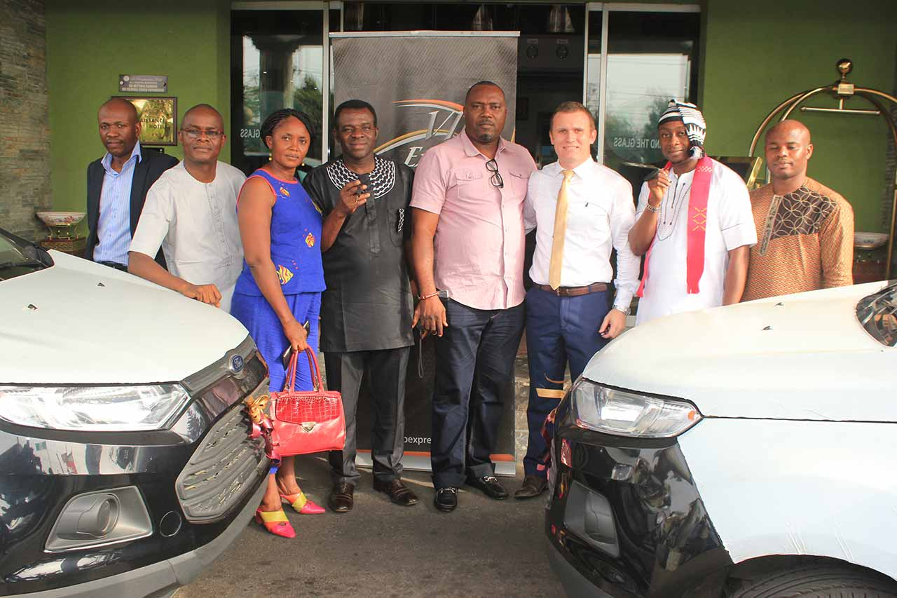 Mr. Chukwu Chukwu of Briscoe Ford (left), Mr. Femi Eguaikhide, GM Briscoe Ford; Mr. and Mrs. Onyeiw (winner), Chief Jude Ogaga Ughawujabo, Head, Regulation and Monitoring – Nigerian Lottery Regulatory Commission; Alwyn Dormehl, Communication Officer, VIP Express Tourism Limited and Chris Ochulo who represented his brother as second winner during the car presentation.