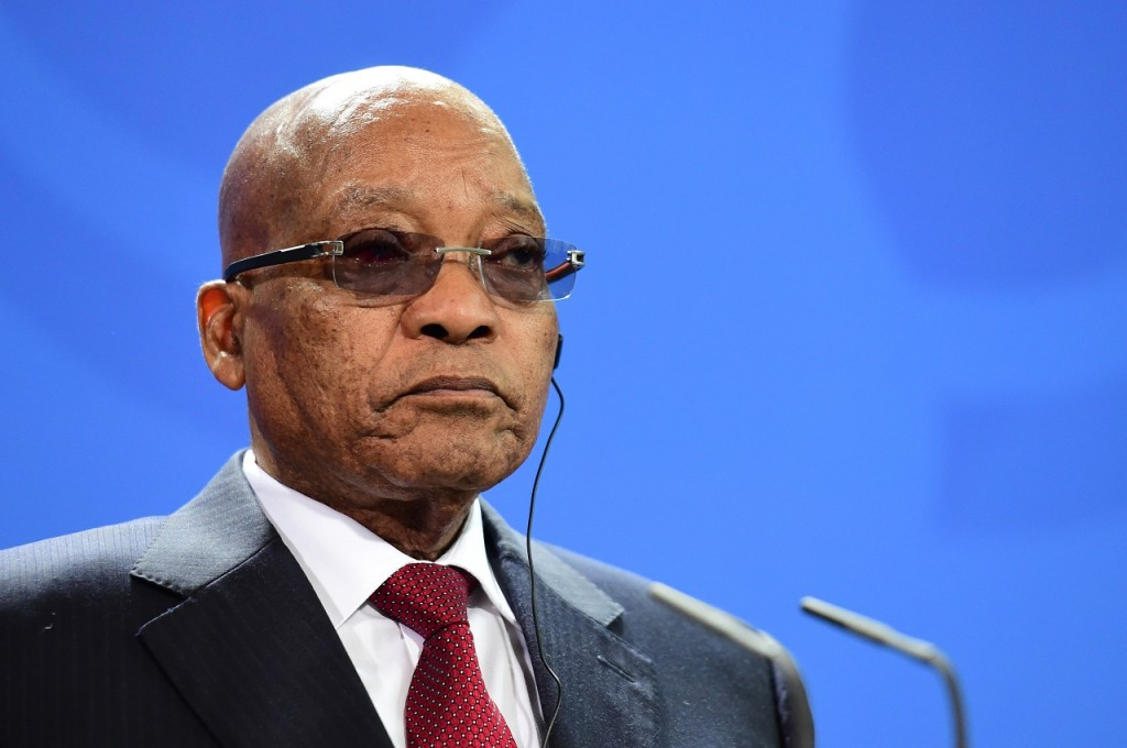 (FILES) This file photo taken on November 10, 2015 shows South African President Jacob Zuma attending a press conference following talks with the German Chancellor at the chancellery in Berlin. Beleaguered South African President Jacob Zuma faces on March 1, 2016 a no-confidence vote in parliament for a second time in less than a year and a legal bid to reinstate corruption charges against him. The mounting pressure on the president comes against a background of economic crisis sparked by his firing of two finance ministers within days in December 2015. / AFP / JOHN MACDOUGALL