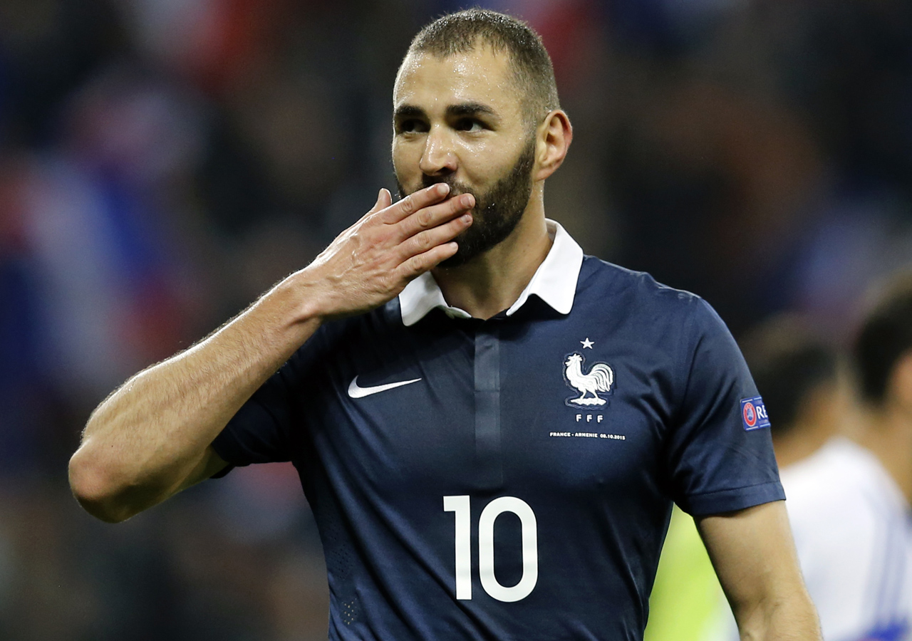 (FILES) This file photo taken on October 09, 2015 shows French forward Karim Benzema celebrating after scoring a goal during the friendly football match between France and Armenia on October 8, 2015 at the Allianz Riviera stadium in Nice, southeastern France. The judicial review of Karim Benzema, indicted in the sex-tape blackmailing affair against Mathieu Valbuena, was lifted on March 11, 2016, by the Versailles Court of Appeal, opening the way to its come-back in the French national team for Euro 2016. / AFP / VALERY HACHE