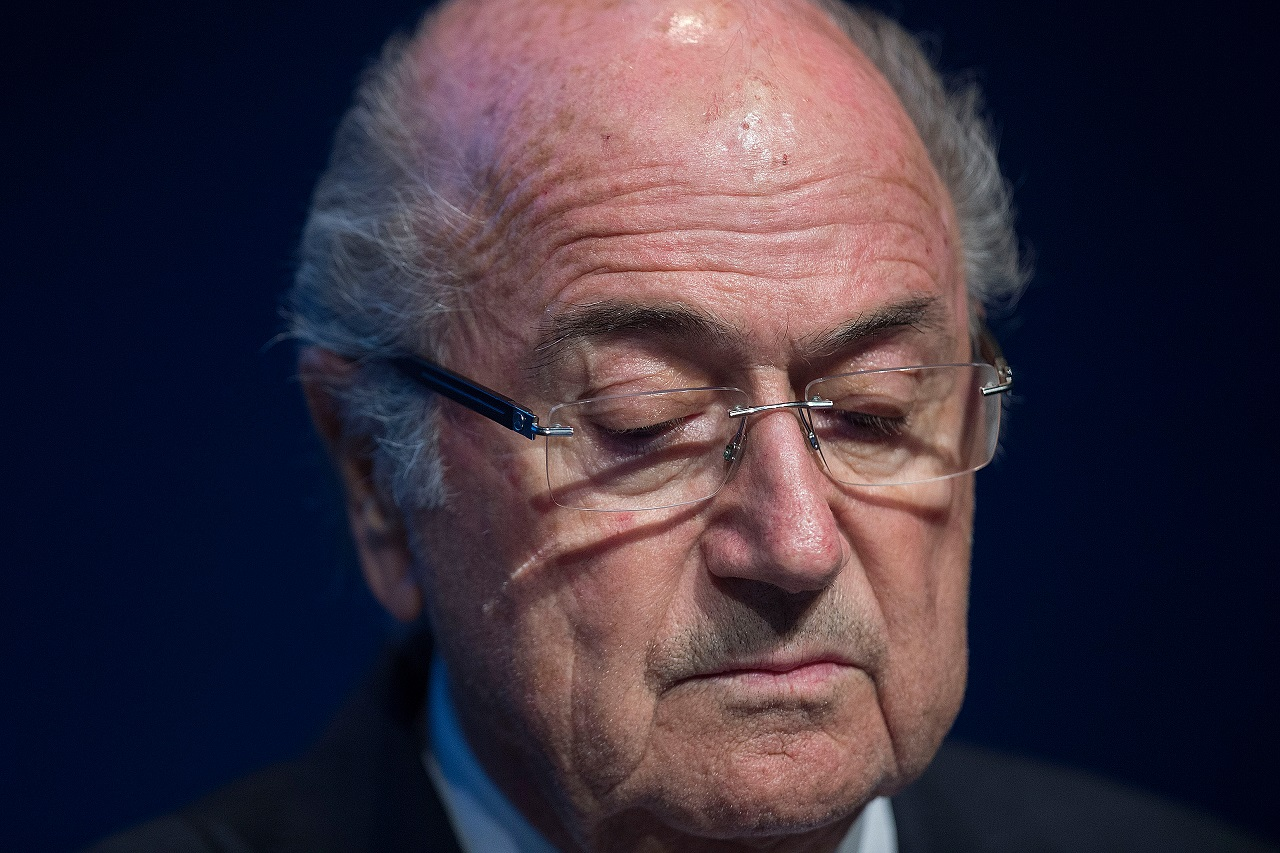 (FILES) This file photo taken on June 02, 2015 shows FIFA President Sepp Blatter looking down during a press conference at the headquarters of the world's football governing body in Zurich. The battle for the FIFA presidency on February 26, 2016 has turned into a gruelling round-the-globe marathon for the five candidates but observers say they are avoiding the real problems facing the scandal-infected world football body. / AFP / VALERIANO DI DOMENICO