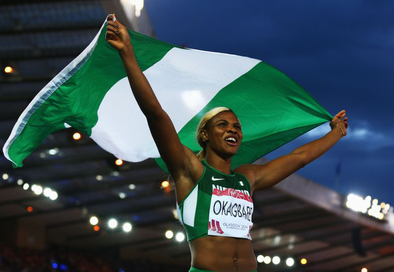 Blessing Okagbare of Nigeria celebrates winning gold in the Women's 100 metres final at Hampden Park during day five of the Glasgow 2014 Commonwealth Games on July 28, 2014 in Glasgow, United Kingdom. PHOTO: Cameron Spencer/Getty