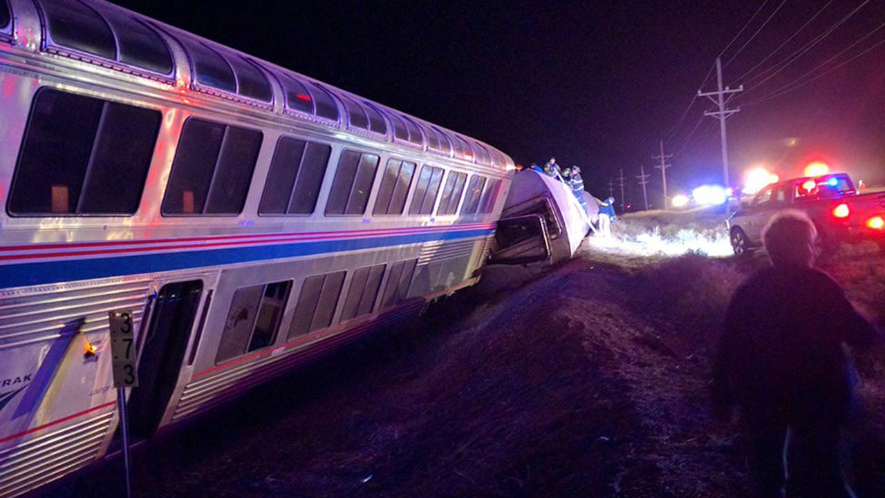 Emergency personnel work on a train that derailed near Dodge City, Kan., Monday, March 14, 2016. An Amtrak statement says the train was traveling from Los Angeles to Chicago early Monday when it derailed just after midnight. PHOTO www.rt.com900