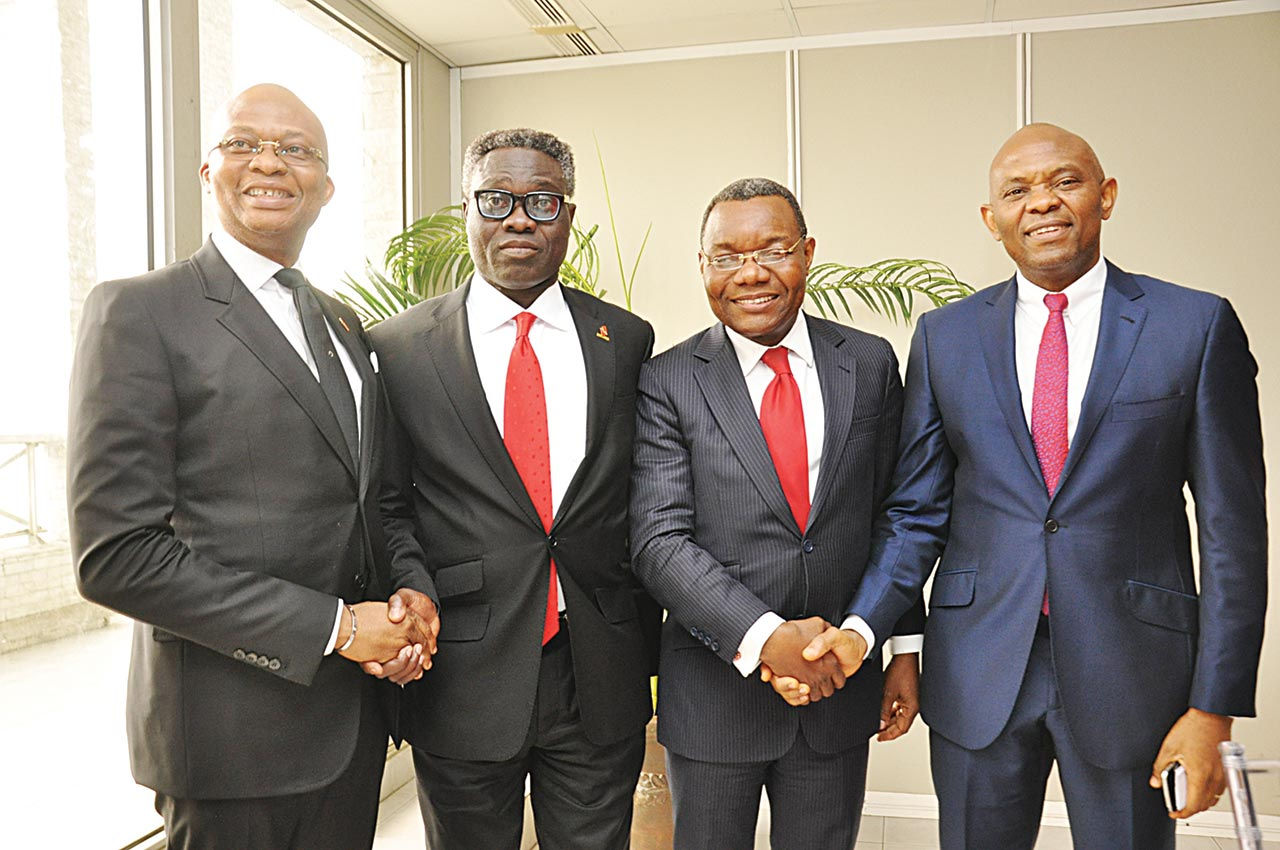 Incoming GMD/CEO United Bank of Africa (UBA), Kennedy Uzoka (left); GMD/CEO UBA, Phillips Oduoza; new DMD, Victor Osadolor and Chairman UBA, Tony Elumelu shortly after the board's appointment of Uzoka and Osadolor in Lagos on Monday. Oduoza's tenure ends on July 31, 2016.
