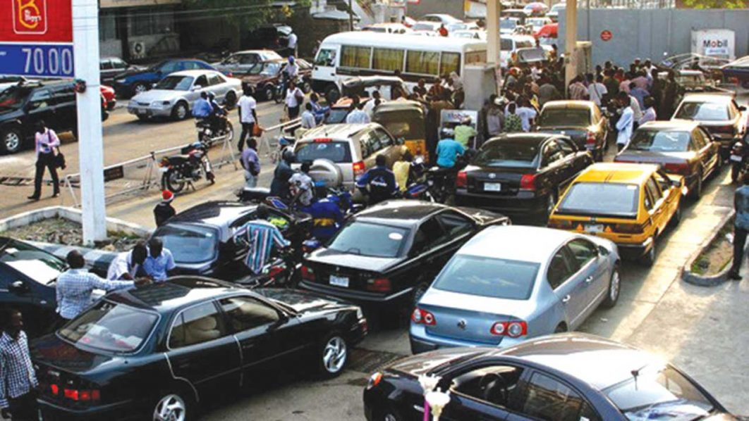 Motorists queue at a filling station