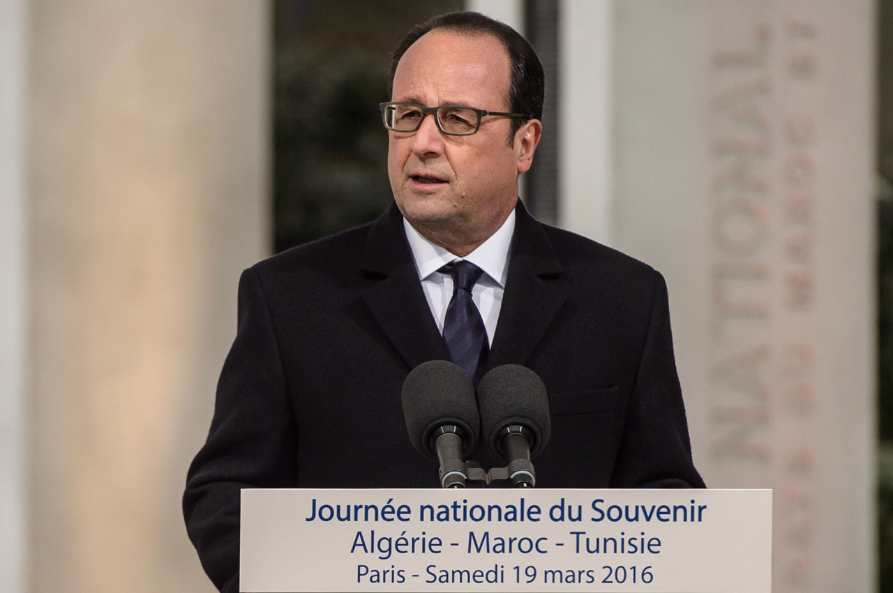 "French President Francois Hollande delivers a speech during a ceremony of commemoration for the end of the Algeria war in Paris on March 19, 2016.  Hollande defended his choice to commemorate the cease-fire of March 19, 1962 in Algeria to honor the victims of this conflict by explaining that this date marked ""not yet peace"" but ""the beginning of the outcome the war"". The presidential initiative was disputed by many associations of veterans and Pieds-noir for whom this date does not mark the end of the Algerian conflict but the beginning of the exile and massacre of civilians and harkis. / AFP / POOL / Christophe Petit Tesson"