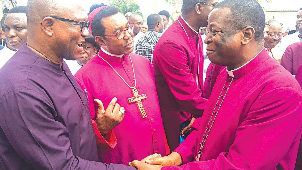 Former Governor of Anambra State, Mr. Peter Obi (left), Archbishop Emmanuel Chukwuma (middle), and other Bishops, welcoming the Primate, Church of Nigeria, Anglican Communion, Most Rev. Dr. Nicholas Okoh (right) to the dedication of Legacy Building at the Trinity Theological College, Umuahia, Abia State