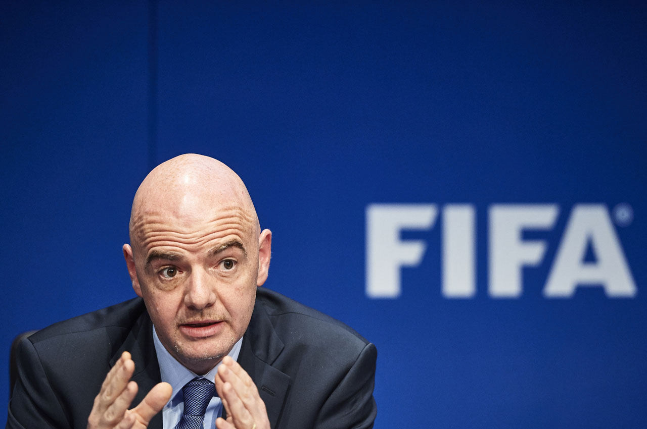 FIFA President Gianni Infantino gestures during a press conference following an executive meeting of the world football governing body at the FIFA headquarters on March 18, 2016 in Zurich.  / AFP / MICHAEL BUHOLZER