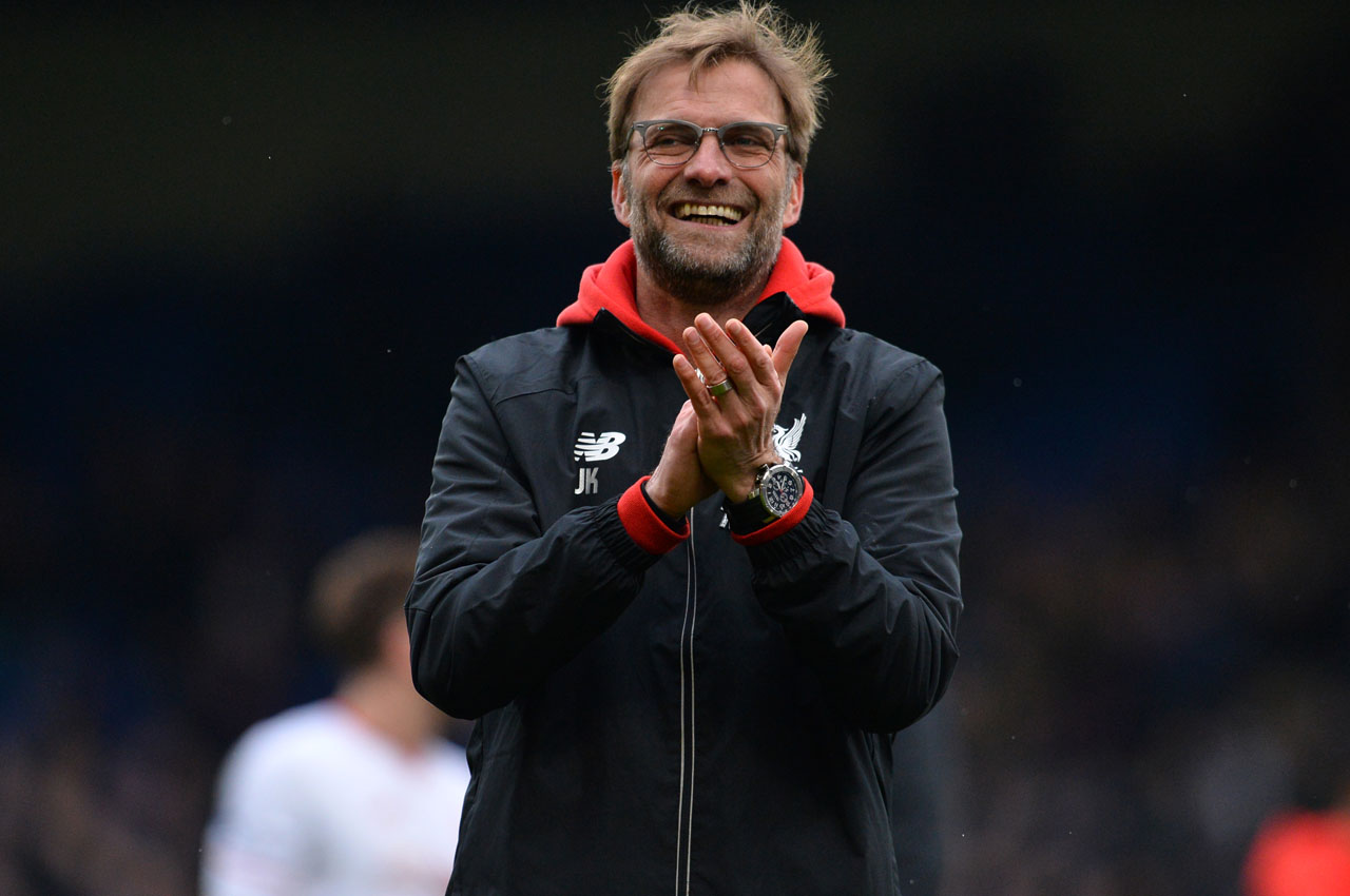 Liverpool's German manager Jurgen Klopp celebrates on the pitch after the English Premier League football match between Crystal Palace and Liverpool at Selhurst Park in south London on March 6, 2016. Liverpool won the game 2-1. / AFP / GLYN KIRK / RESTRICTED TO EDITORIAL USE. No use with unauthorized audio, video, data, fixture lists, club/league logos or 'live' services. Online in-match use limited to 75 images, no video emulation. No use in betting, games or single club/league/player publications.  /