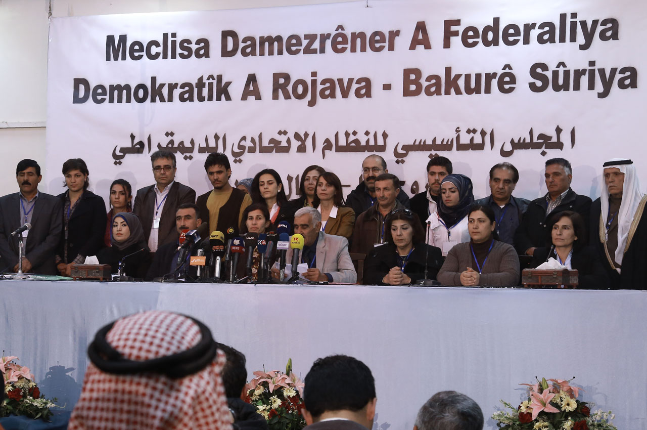 Syrian delegates from Kurdish, Arab, Assyrian and other parties take part in a conference in which they announced a federal system in Syria's Kurdish-controlled northern regions, in the town of Rmeilan, in Syria's northeastern Hasakeh province, on March 17, 2016. Syria's Kurds declared a federal region in areas under their control in the north of the conflict-riven country, a move rejected by both the government and opposition.  / AFP / DELIL SOULEIMAN