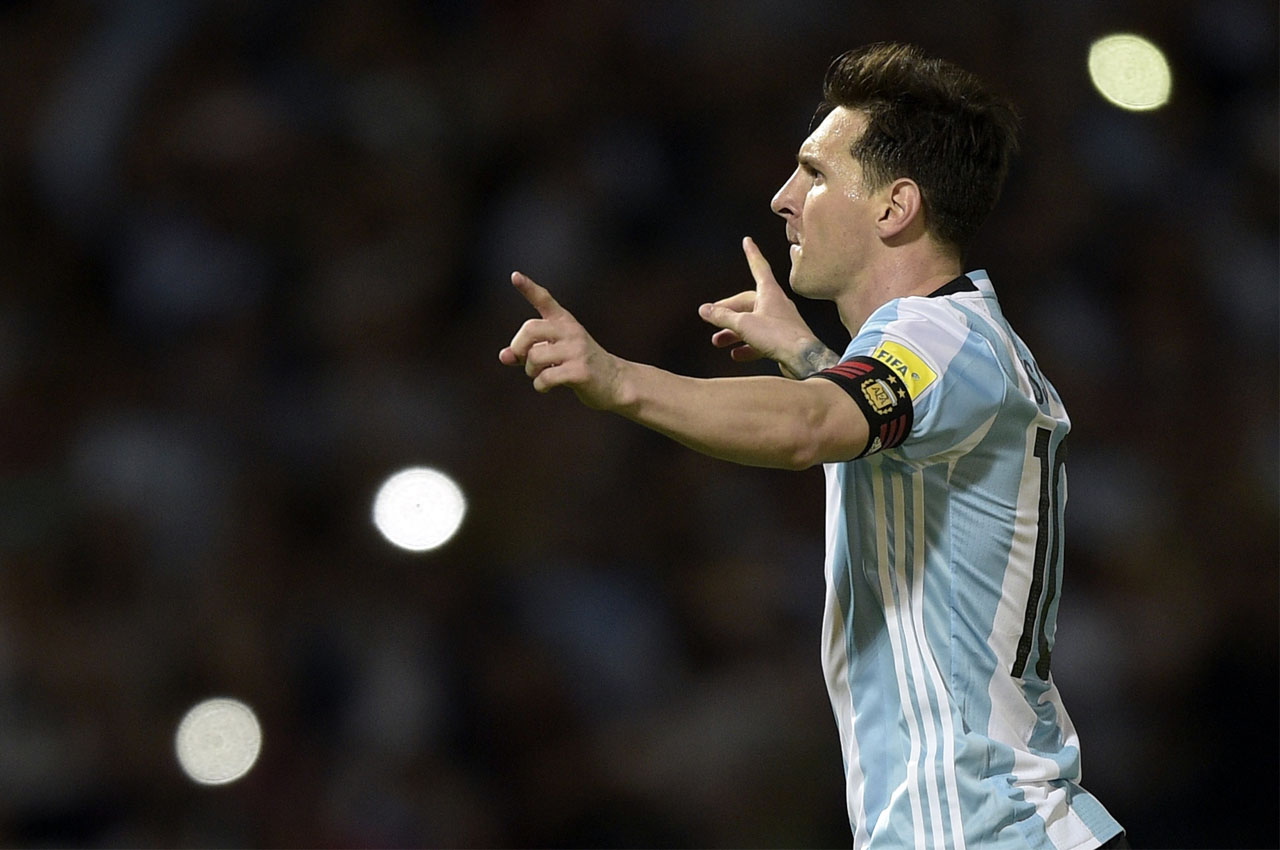 Argentina's Lionel Messi celebrates after scoring against Bolivia during their Russia 2018 FIFA World Cup South American Qualifiers' football match in Cordoba, Argentina, on March 29, 2016. AFP PHOTO / JUAN MABROMATA / AFP / JUAN MABROMATA