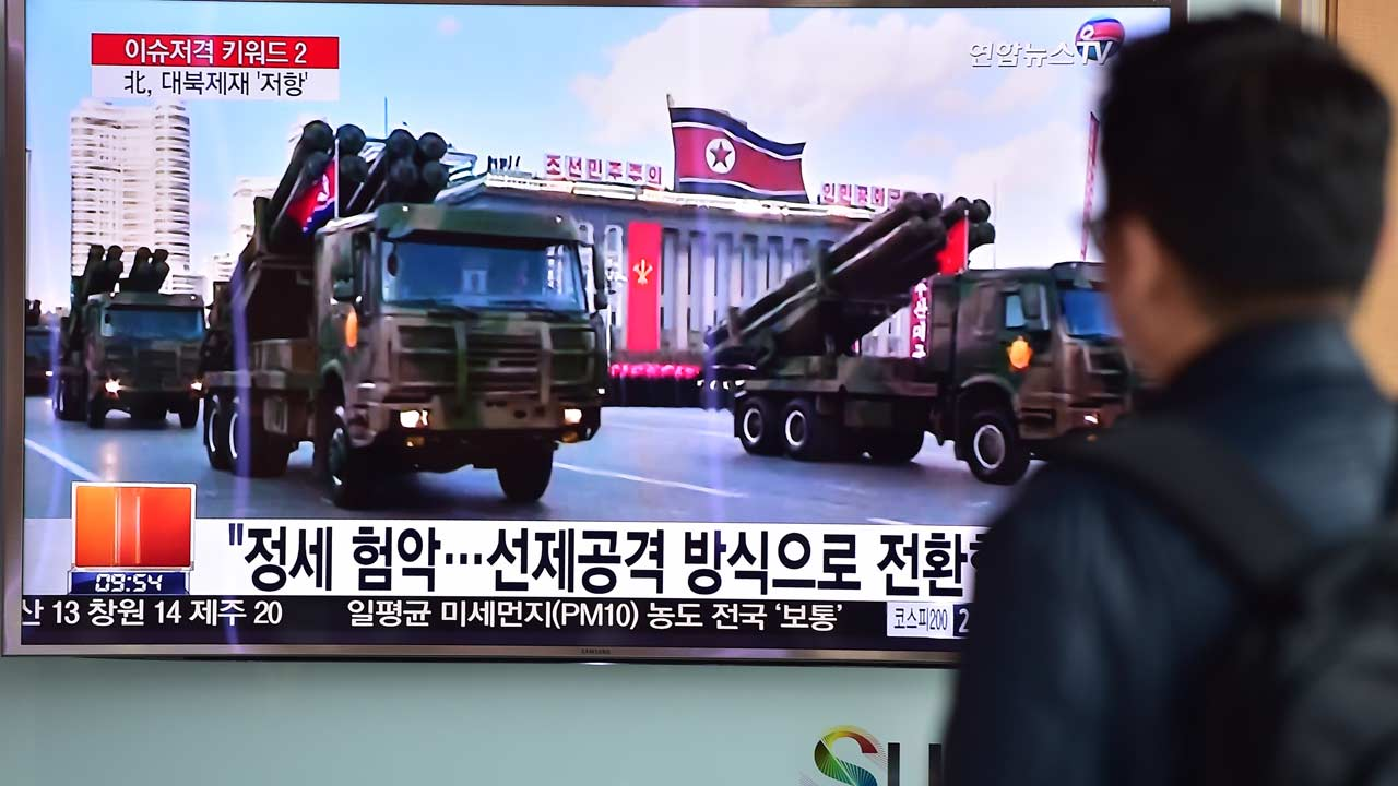 A man watches a news report showing file footage of North Korean missiles on parade, at a railway station in Seoul on March 4, 2016. North Korean leader Kim Jong-Un has ordered its nuclear arsenal readied for pre-emptive use at anytime, in an expected ramping up of rhetoric following the UN Security Council's adoption of tough new sanctions on Pyongyang. AFP PHOTO / JUNG YEON-JE JUNG YEON-JE / AFP