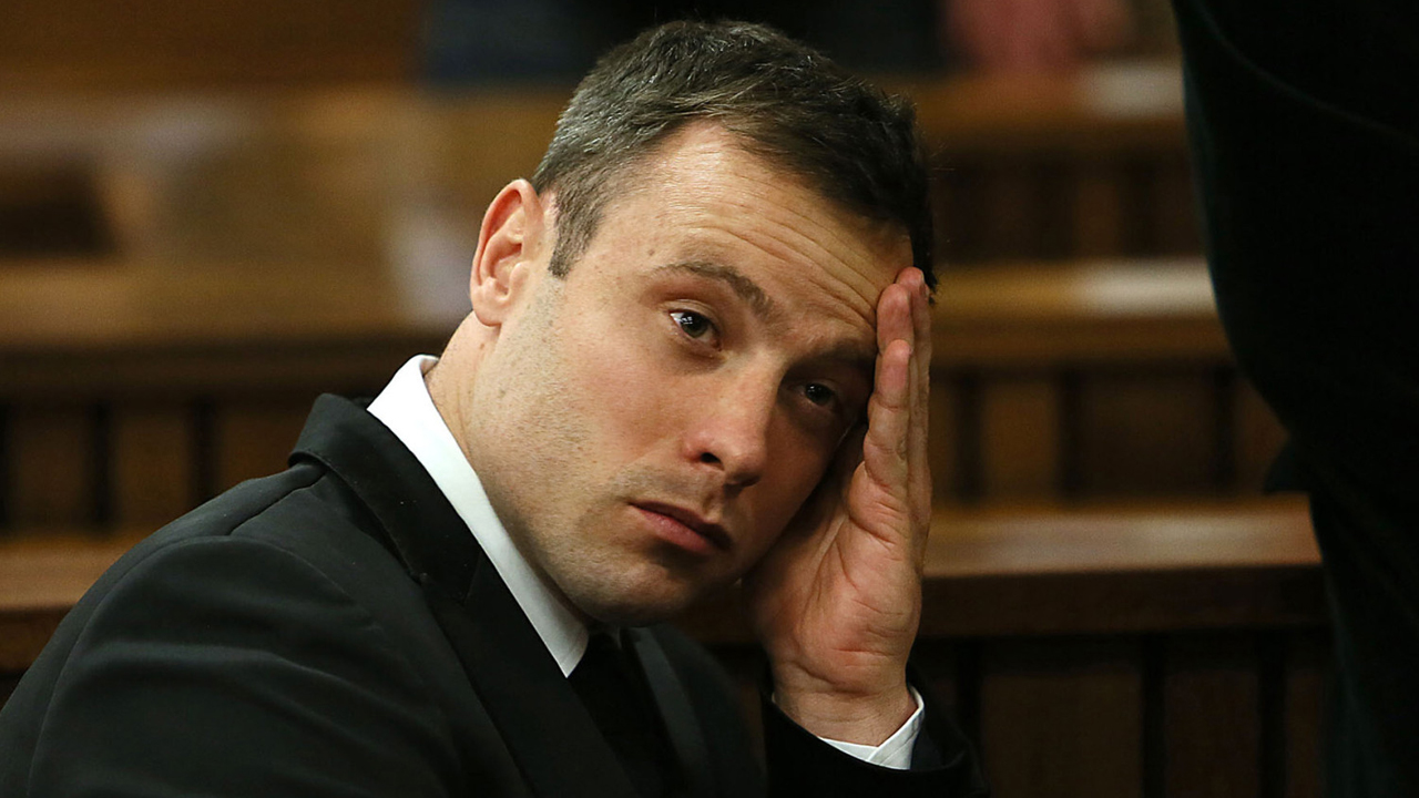 Oscar Pistorius, gestures, at the end of the fourth day of sentencing proceedings in the high court in Pretoria, South Africa, Thursday, Oct. 16, 2014. Following the testimony hearing, which is expected to end this week, Judge Thokozile Masipa will rule on what punishment Pistorius must serve after convicting him of culpable homicide for shooting his girlfriend Reeva Steenkamp through a toilet door in his home.(AP Photo/Alon Skuy, Pool)