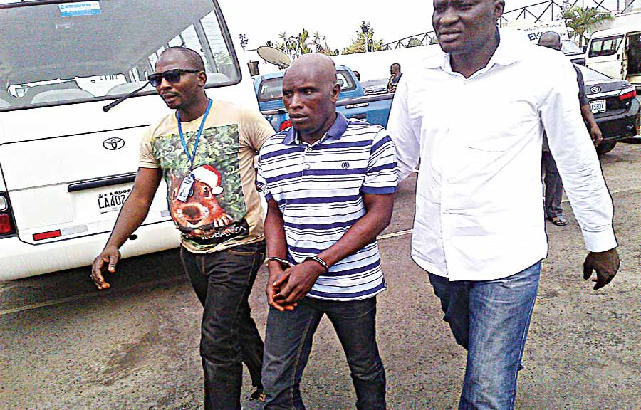 Suspected mastermind of the abduction of the three Ikorodu schoolgirls, Emmanuel Arigidi (middle) being escorted by policemen at Alausa, Lagos… yesterday PHOTO: BERTRAM NWANNEKANMA