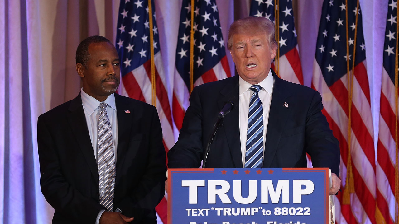 PALM BEACH, FL - MARCH 11: Republican presidential candidate Donald Trump stands with former presidential candidate Ben Carson as he receives his endorsement at the Mar-A-Lago Club on March 11, 2016 in Palm Beach, Florida. Presidential candidates continue to campaign before Florida's March 15th primary day.   Joe Raedle/Getty Images/AFP