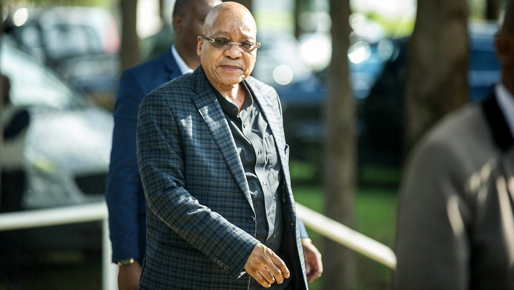 """(FILES) This file photo taken on March 18, 2016 shows South African President and South African ruling party African National Congress leader Jacob Zuma arriving to attend the National Executive Committee (NEC) ordinary meeting at the St. Georges Hotel, in Centurion, South Africa. South Africa's top court announced on March 31, 2016 that Jacob Zuma """"failed to uphold"""" the constitution. MUJAHID SAFODIEN / AFP"""