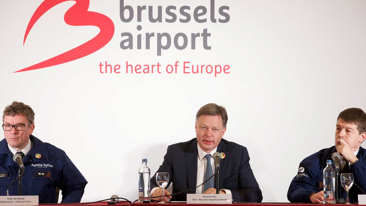 (LtoR) Federal Police spokesman Peter De Waele, Brussels Airport CEO Arnaud Feist and Federal Police spokesman Michael Jonniaux give a press conference regarding the reopening of Brussels Airport on April 2, 2016 in Zaventem. Brussels Airport is to reopen Sunday, 12 days after its departure hall was wrecked by Islamic State suicide bombings, with chief executive Arnaud Feist announcing three flights. A total of 32 people were killed in the March 22 attacks on the airport and a metro station in Brussels. NICOLAS MAETERLINCK / BELGA / AFP