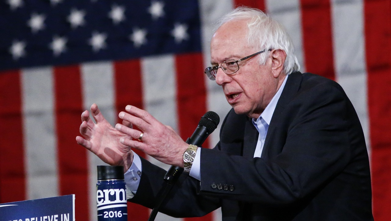 Democratic presidential candidate Bernie Sanders addresses a rally at the Bronx Community College in New York on April 9,2016. According to the RealClearPolitics poll average, Sanders trails Democratic frontrunner Hillary Clinton 42.5 to 53.5 percent in the April 19 New York primary, the next key battleground in the US presidential race. Sanders, who was born and raised in Brooklyn, needs a win in Clinton's adopted home state to help keep alive his dreams of the White House.  / AFP PHOTO / KENA BETANCUR
