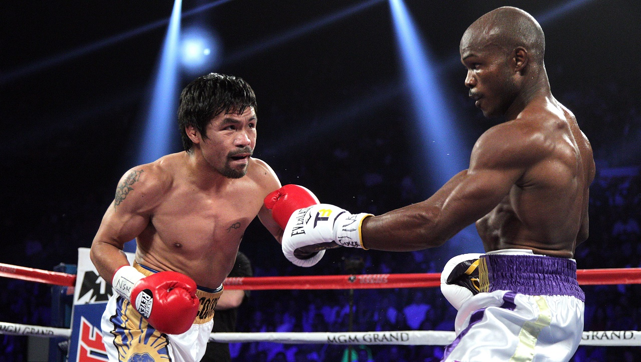 Manny Pacquiao of the Philippines (L) fights against Timothy Bradley Jr. (R) during their WBO international welterweight title boxing bout at the MGM Grand Arena in Las Vegas, Nevada on April 9, 2016. / AFP PHOTO / John GURZINSKI