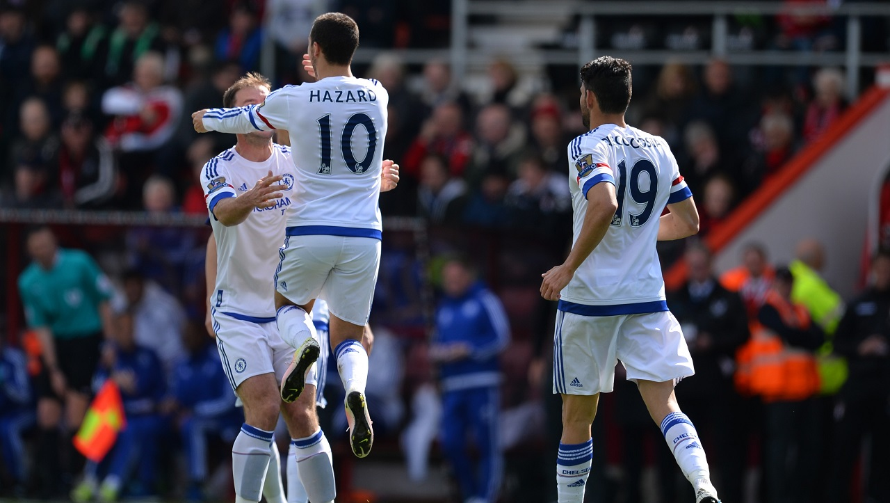 Chelsea's Belgian midfielder Eden Hazard (2nd L) celebrates with Chelsea's Serbian defender Branislav Ivanovic (L) after scoring their second goal during the English Premier League football match between Bournemouth and Chelsea at the Vitality Stadium in Bournemouth, southern England on April 23, 2016. / AFP PHOTO / GLYN KIRK / RESTRICTED TO EDITORIAL USE. No use with unauthorized audio, video, data, fixture lists, club/league logos or 'live' services. Online in-match use limited to 75 images, no video emulation. No use in betting, games or single club/league/player publications.  /