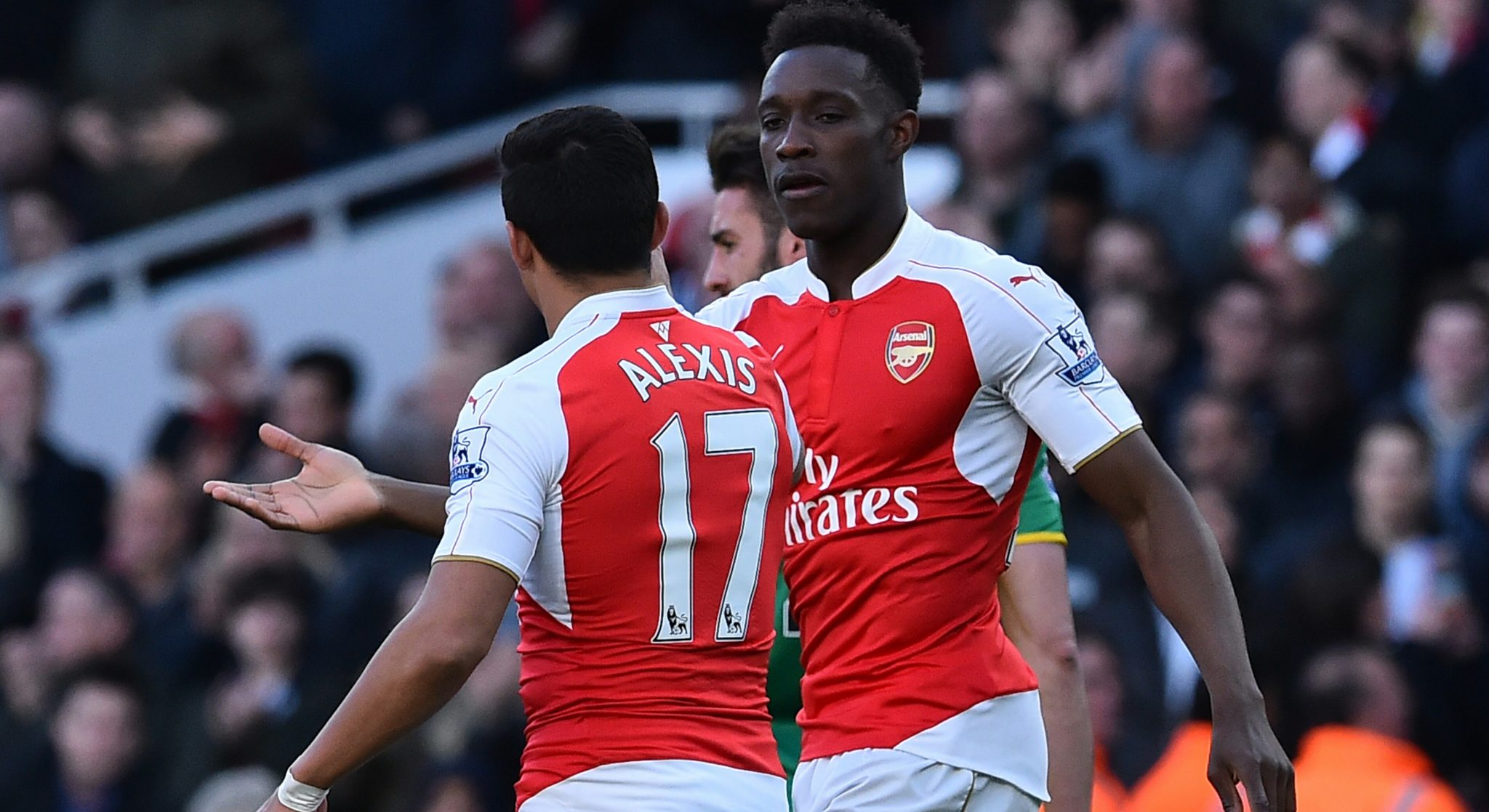 rsenal's English striker Danny Welbeck (R) celebrates with Arsenal's Chilean striker Alexis Sanchez (L) after scoring the opening goal during the English Premier League football game against Norwich. PHOTO: AFP/BEN STANSALL