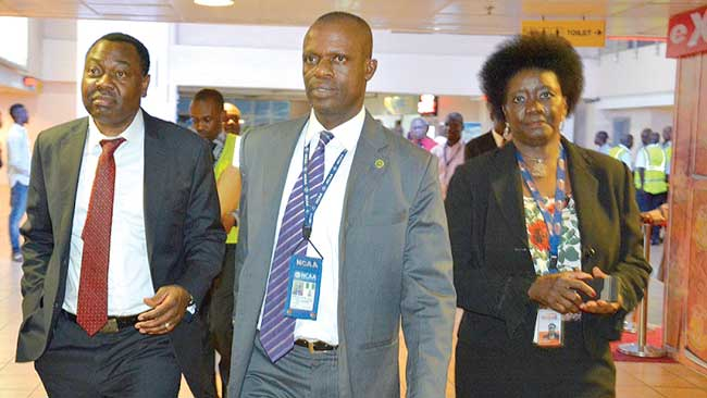 President, International Civil Aviation Organisation (ICAO), Dr. Olumuyiwa Aliu (left), GM, Public Relations, Nigerian Civil Aviation Authority, Mr. Sam Adurogboye and Chief Operations Officer, Bi-Courtney Aviation Services Ltd, Ms. Adebisi Awoniyi, during Aliu's arrival at the Murtala Muhammed Airport Two from Abuja, for his return journey to ICAO Headquarters, Canada… during the week.