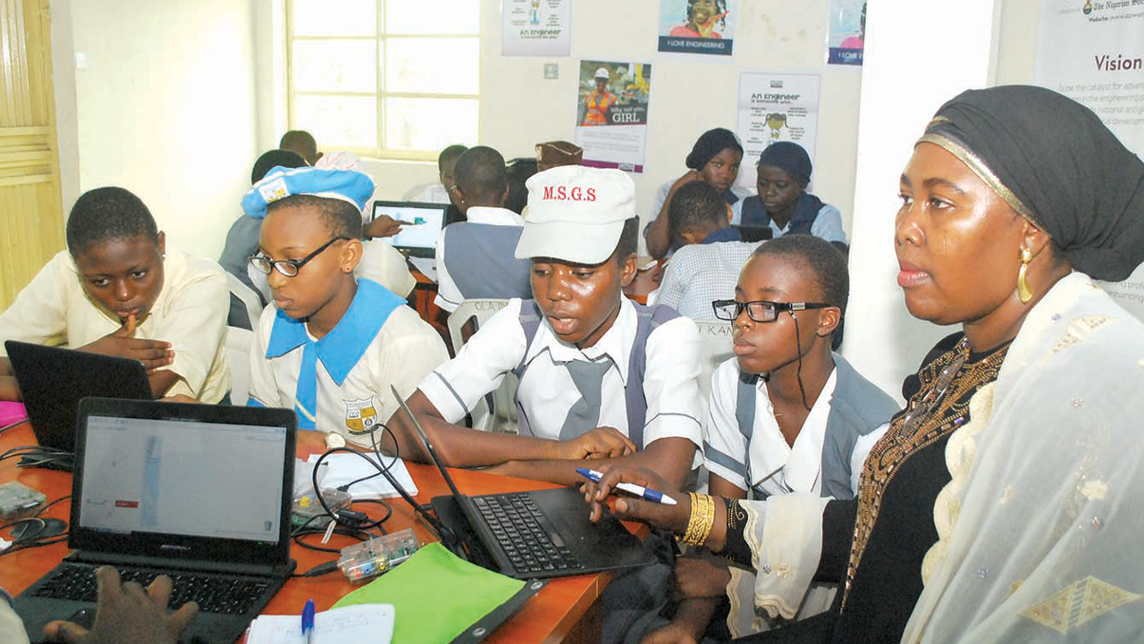 President, Association of Professional Women Engineers of Nigeria (APWEN), Hauwa Mohammed(right); with some students of Lagos State secondary schools during a three-day Code Workshop organised by Working to Advance African Women (WAAW) Foundation in collaboration with APWEN in Lagos. PHOTO: AYODELE ADENIRAN