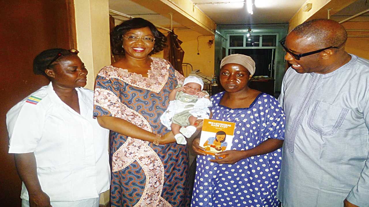 """Matron of Island Maternity Hospital, Lagos, Mrs. B. Eddo (left); Chief Executive Officer (CEO)/Executive Director of Child Health Advocacy Initiative (CHAI), Mrs. Lola Alonge; mother with baby; Medical Director of Island Maternity Hospital, Lagos, Dr. Donald Imosemi, at the presentation of Alonge's new book, """"Breastfeeding Made Easy,"""" to mothers at Island Maternity Hospital, Lagos"""