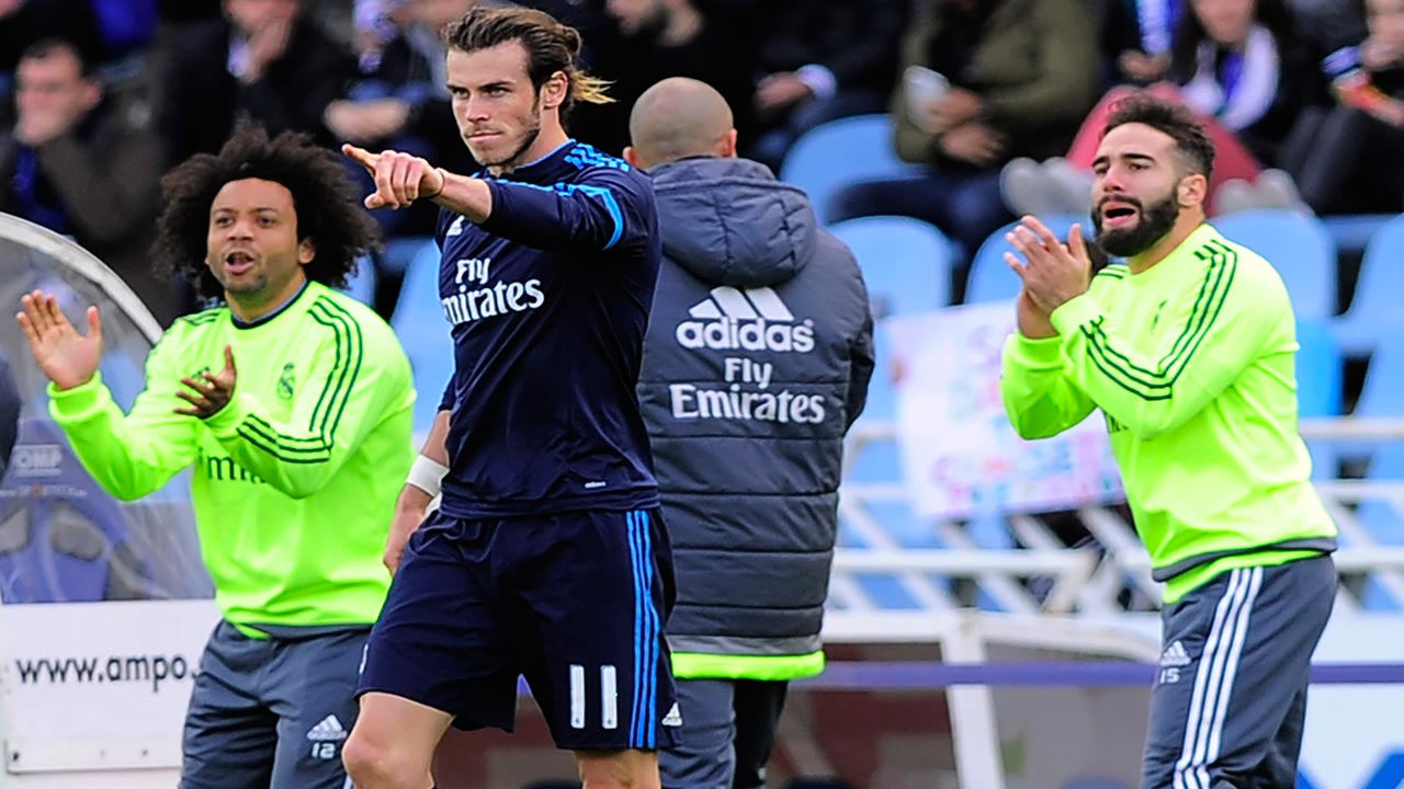 Real Madrid's Welsh forward Gareth Bale (C) celebrates a goal next to Real Madrid's Brazilian defender Marcelo (L) and Real Madrid's defender Dani Carvajal (R) during the Spanish league football match Real Sociedad vs Real Real Madrid CF at the Anoeta stadium in San Sebastian on April 30, 2016. ANDER GILLENEA / AFP