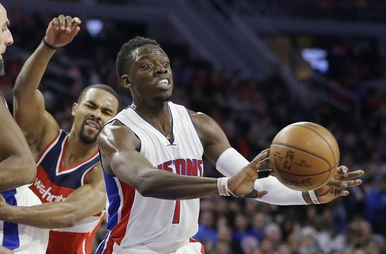 Detroit Pistons guard Reggie Jackson passes the ball as Washington Wizards guard Ramon Sessions closes in during the first half of an NBA basketball game. photo: dailyjournal.net